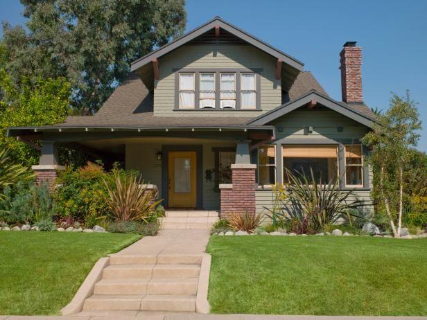 Sage Green Home Exterior With Yellow Front Door