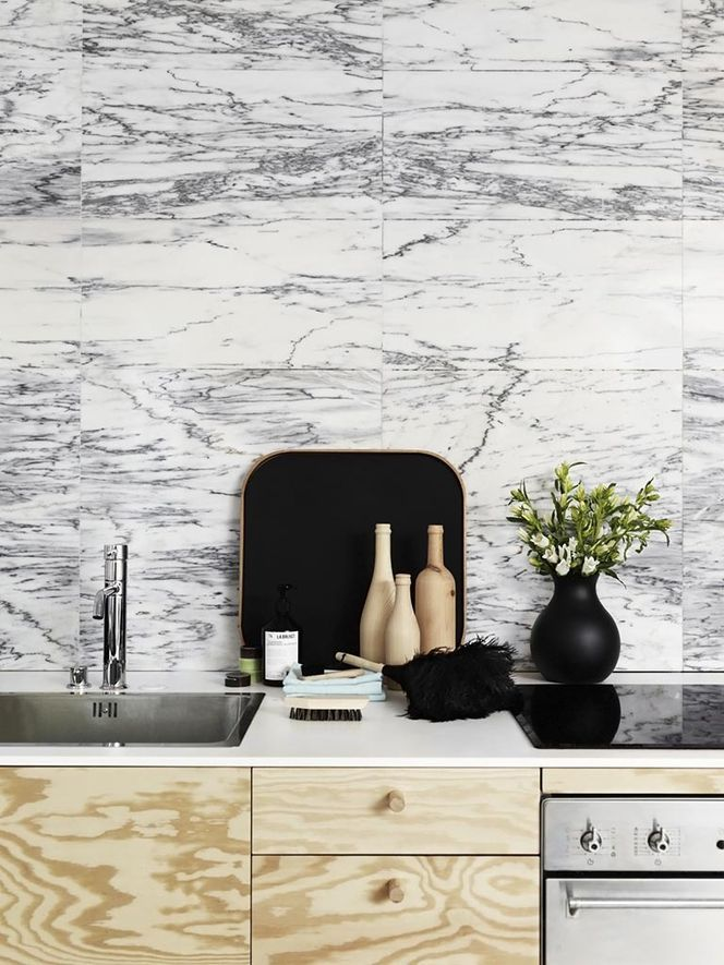 Lots of pattern. Marble kitchen walls