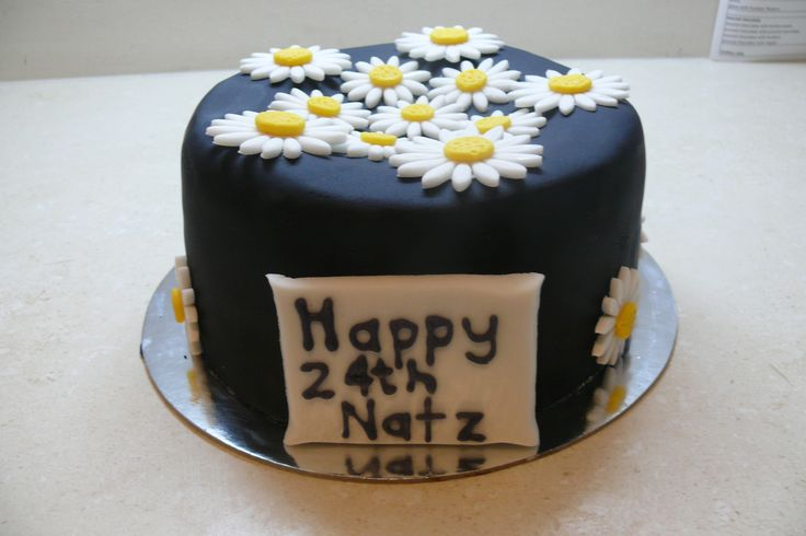 This striking black cake, is sure to be the main event at any celebration! www.glutenfreecakenation.com.au