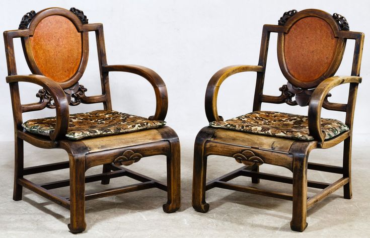 Lot 61: Asian Rosewood Chairs; Two chairs having carved details, removable seat cushions, faux painted burl wood oval insert in back splat, overall Asian style