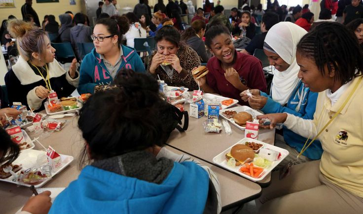 """Immigrants find education, companions in school in Harris County, where more than 1 million residents are foreign born  The cafeteria, hushed and empty just a minute earlier, now shudders and shakes with the rumble of nearly 700 teenagers.  Here, a group of girls cluster, their laughter chiming like church bells on a Sunday morning.  The first time Mary joined the group of near-strangers, she recalls, it was a """"little awkward.""""  [...] the table quickly turned into a haven, where there is…"""