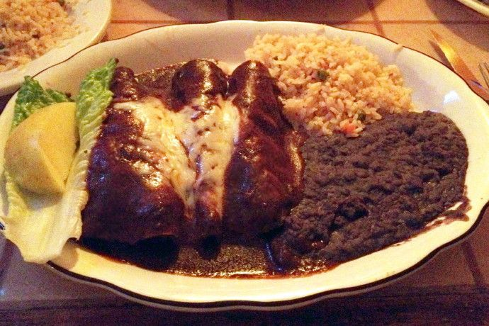Photo of enchiladas with mole sauce from El Sarape, Braintree, Massachusetts (from http://hiddenboston.com/foodphotos/el-sarape-mole.html)