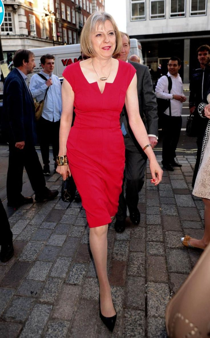 Theresa May wears a red fitted dress to the Royal Academy Summer Exhibition…