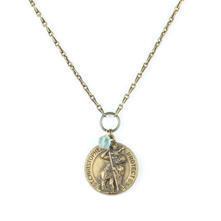"""Vintage St. Christopher Medallion embellished with a blue quartz square cut stone, hangs on a 30"""" oxidized brass chain. Medallion is appx 1"""" in diameter. St. Christopher is the patron Saint of travel"""
