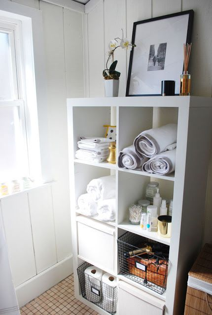 Ikea Expedit in bathroom - I'd add little feet on it to keep it off the floor though, since it's particle-board and isn't water-friendly.