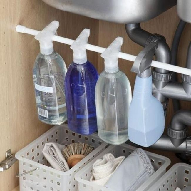 Insert a rod under your sink to hang your cleaners from.