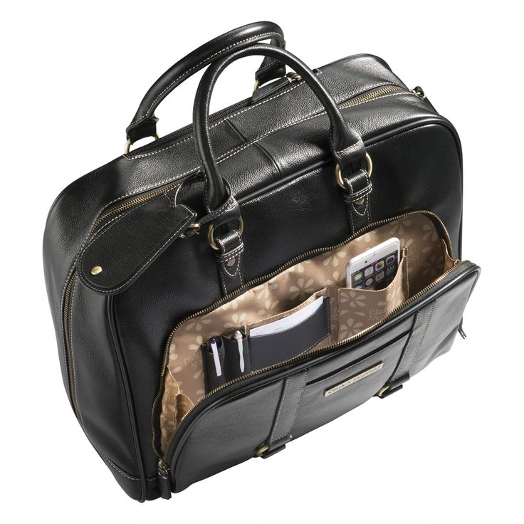 Perfect travel bag: fits your laptop, phone, passport, pens, and so much more. Rolling leather laptop bag.