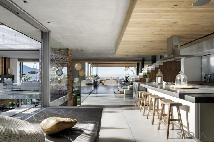 Glen 2961 House by SAOTA and Three 14 Architects.  Open plan living. Kitchen to balcony. Stove on the island instead of against the wall. Water feature to the house. There are many things I like here.