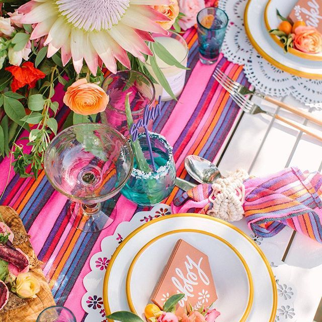 Hoping our dinner looks something like this tonight!  Sharing this colorful #cincodemayo party #onGWS right now thanks to  planning & design: @beijosevents // terra cotta signage: @meghannminiello // blankets: @siestasforfiestas // glassware + woven bowl: @thelittlemarket // photo: @yasminsarai // flowers: @bloomwellandco #fiesta #terracotta #GWSentertaining
