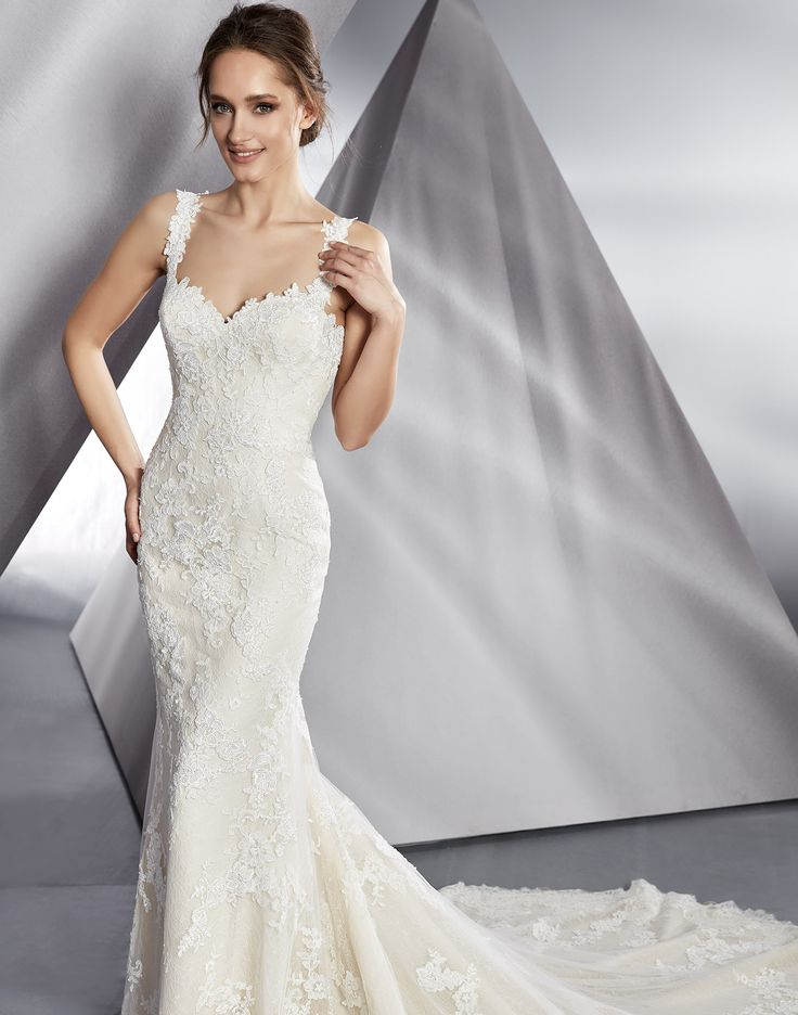 BEAUTIFUL // A full and luxurious sleek lace wedding dress with an intricate low lace back and dramatic lace train