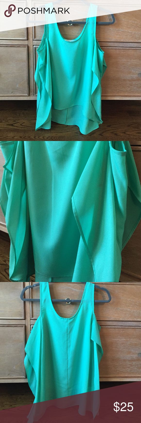BCBG Top Barely ever worn in great condition BCBG mint green silk top. BCBGeneration Tops Blouses