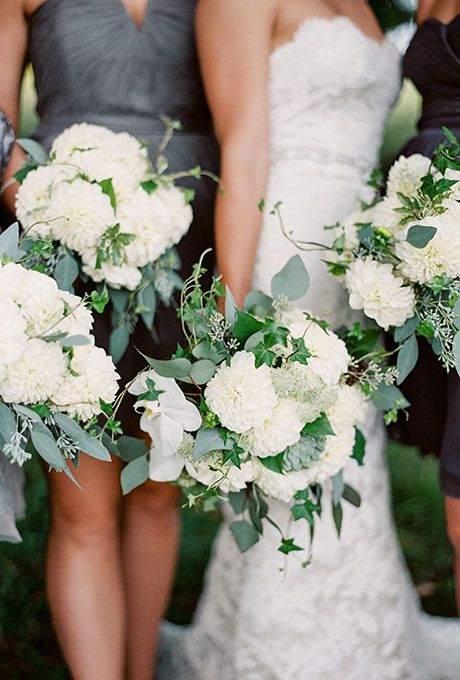 Brides.com: . Lush bouquet comprised of dahlias, eucalyptus, and ivy, accented with hydrangeas, created by  Mode Function.