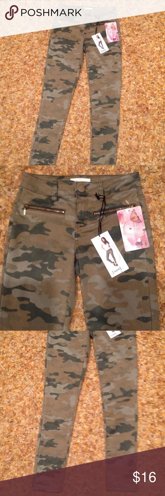 New Love fire junior camouflage skinny jeans Sz 1 Brand new with tag attached... Sz 1... Juniors...Camouflage print... Zippers at front sides... Skinny... Staple piece Love fire Jeans Skinny