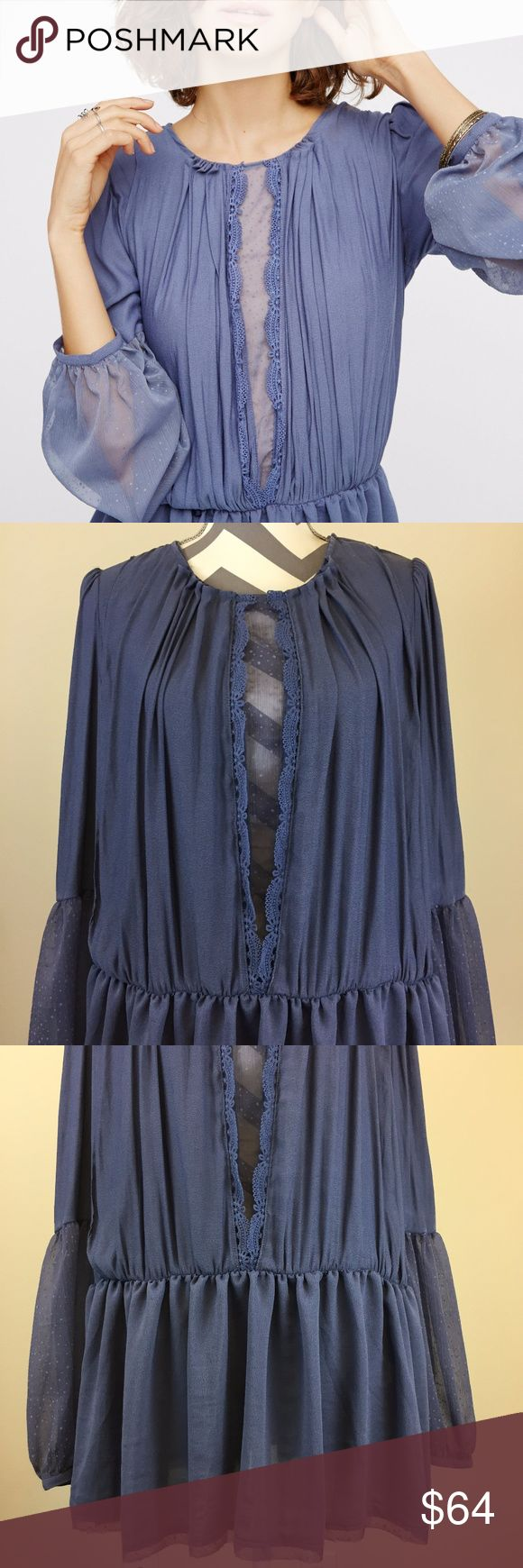NEW Free People Blue Lace Inset Top w/Puff Sleeves Soft blue Free People top with pleated front, lace insets and open back. Pullover style with elastic waist. Fabric: 100% polyester Free People Tops