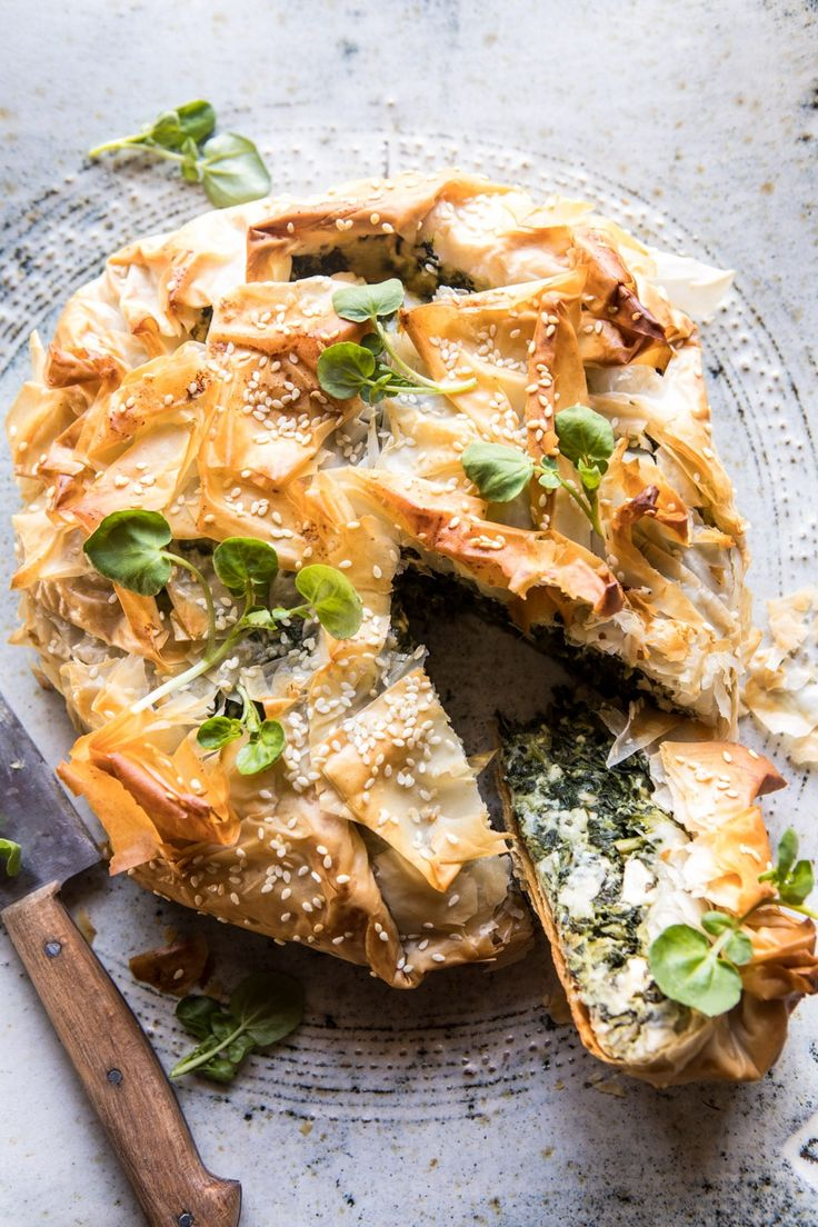 Greek Spinach and Feta Pie (Spanakopita): Traditionally, this dish is referred to as Spanakopita, which is basically just a mix of a lot of spinach, some eggs, herbs, and a generous amount of feta. @halfbakedharvest.com