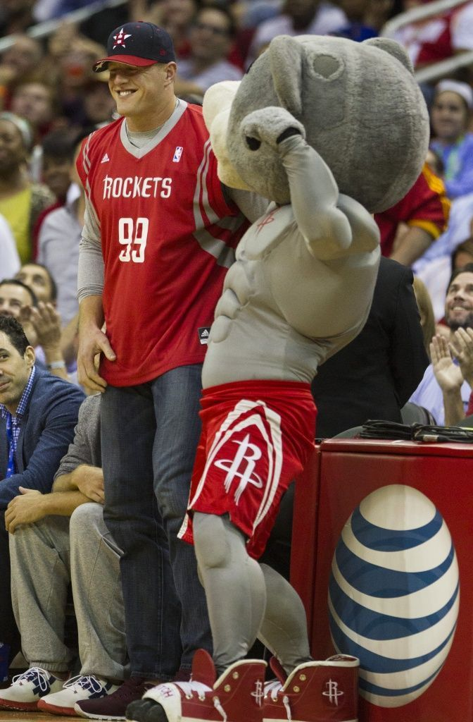 J.J. Watt at Rockets gamesHouston Texans defensive end J.J. Watt, left, dons a Houston Rockets jersey as he stands with Rockets mascot Clutch during the second half of an NBA basketball game against the Oklahoma City Thunder at Toyota Center Monday, Nov. 2, 2015, in Houston. ( Brett Coomer / Houston Chronicle ) Photo: Houston Chronicle