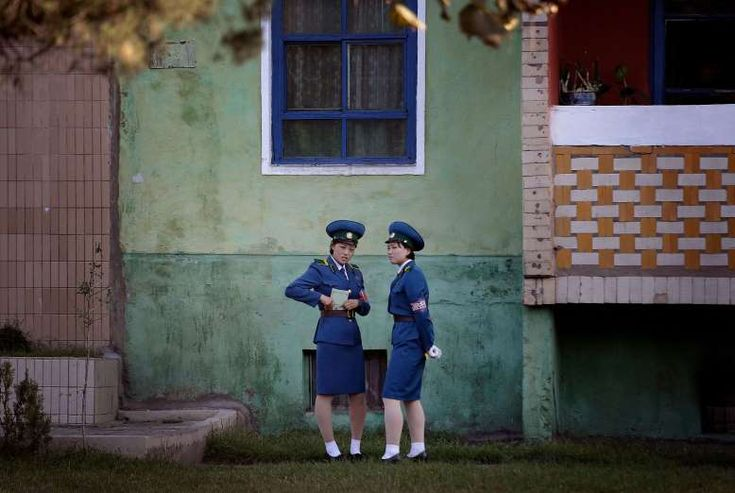 North Korean traffic police women chat next to a residential building while off duty Oct. 18, 2016, in Pyongyang.