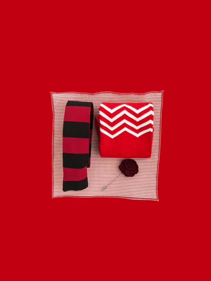 The Red Style Pack - perfect holiday gift for the men in your life. Striped red and black tie, red zig zag socks, red seersucker pocket square and a red rose lapel pin.