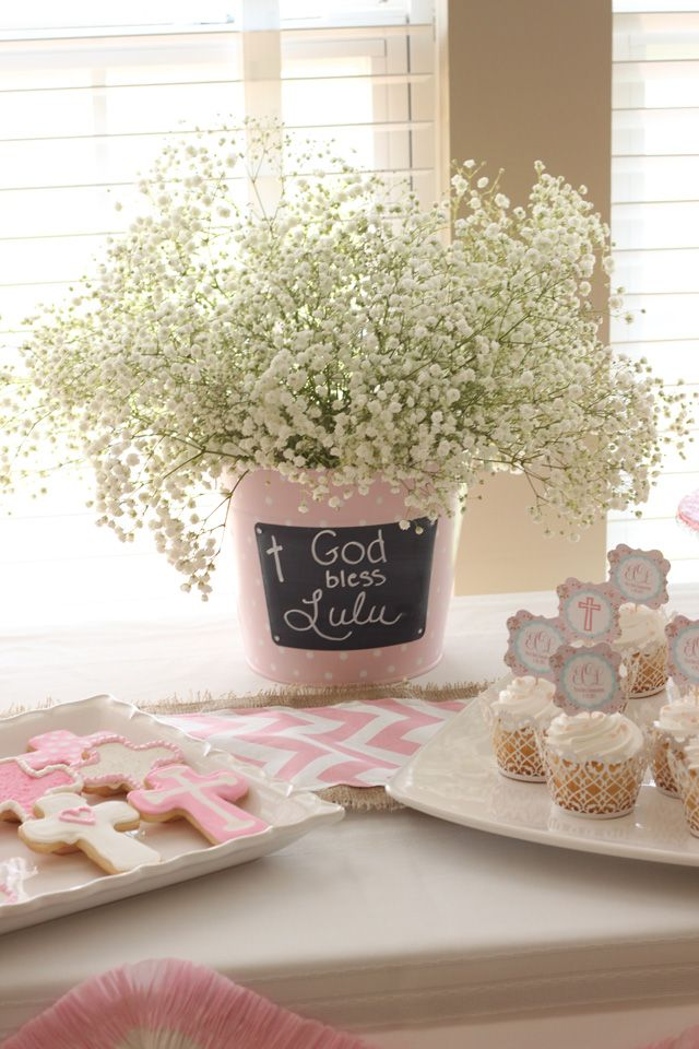 First communion centerpiece. Pink and white theme.