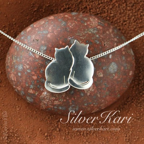 Two Cats on a chain, all in sterling silver