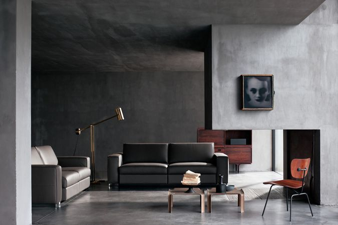 Minimal living room with fireplace.  Photo by Renai & Renai.