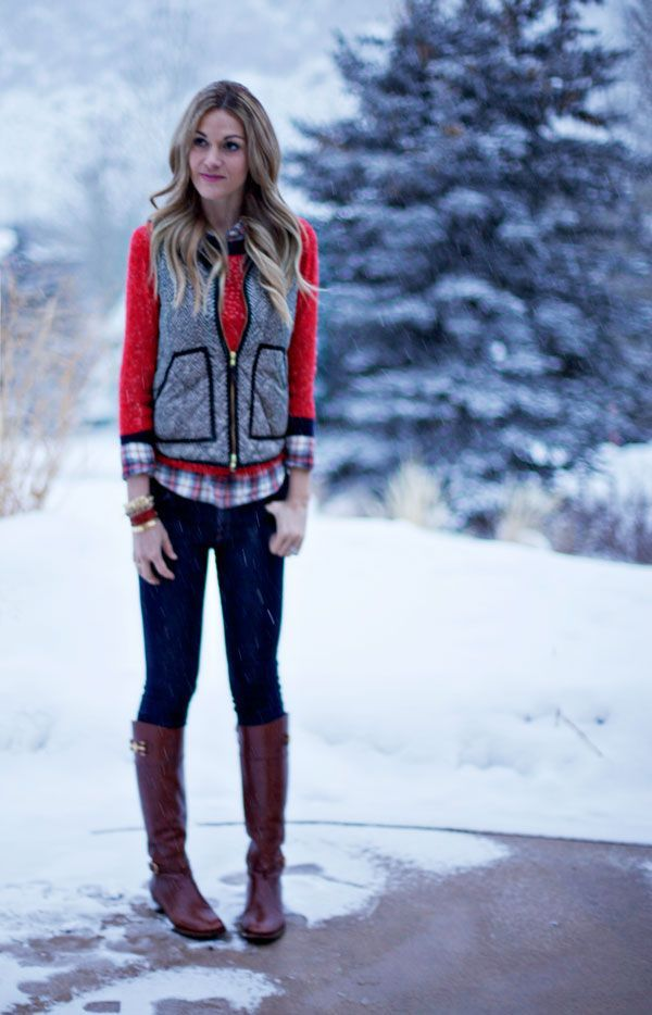 A grey quilted vest and navy skinny jeans will give off this very sexy and chic vibe. A cool pair of brown leather knee high boots is an easy way to upgrade your look.  Shop this look for $94:  http://lookastic.com/women/looks/vest-crew-neck-sweater-dress-shirt-skinny-jeans-knee-high-boots-bracelet/7055  — Grey Quilted Vest  — Red Crew-neck Sweater  — Red Plaid Dress Shirt  — Navy Skinny Jeans  — Brown Leather Knee High Boots  — Red Bracelet