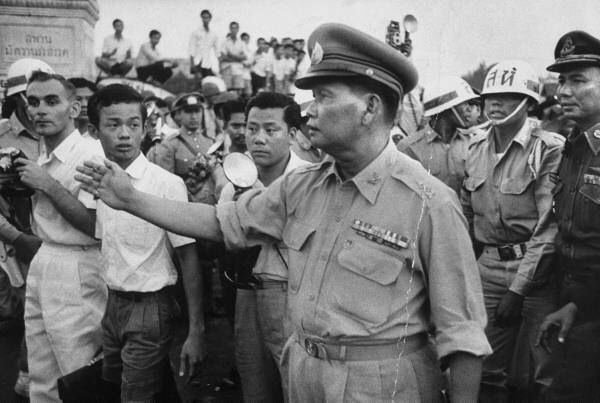 Field Marshall Sarit Thanarat taking control of student demonstrations against the election methods of military dictator and PM Phibun Songgrom. FM Thanarat served as PM from 1959-1963. Just a contemporary history of rotating military regimes....up to the present. Military presence into civil Thai politics is historic.