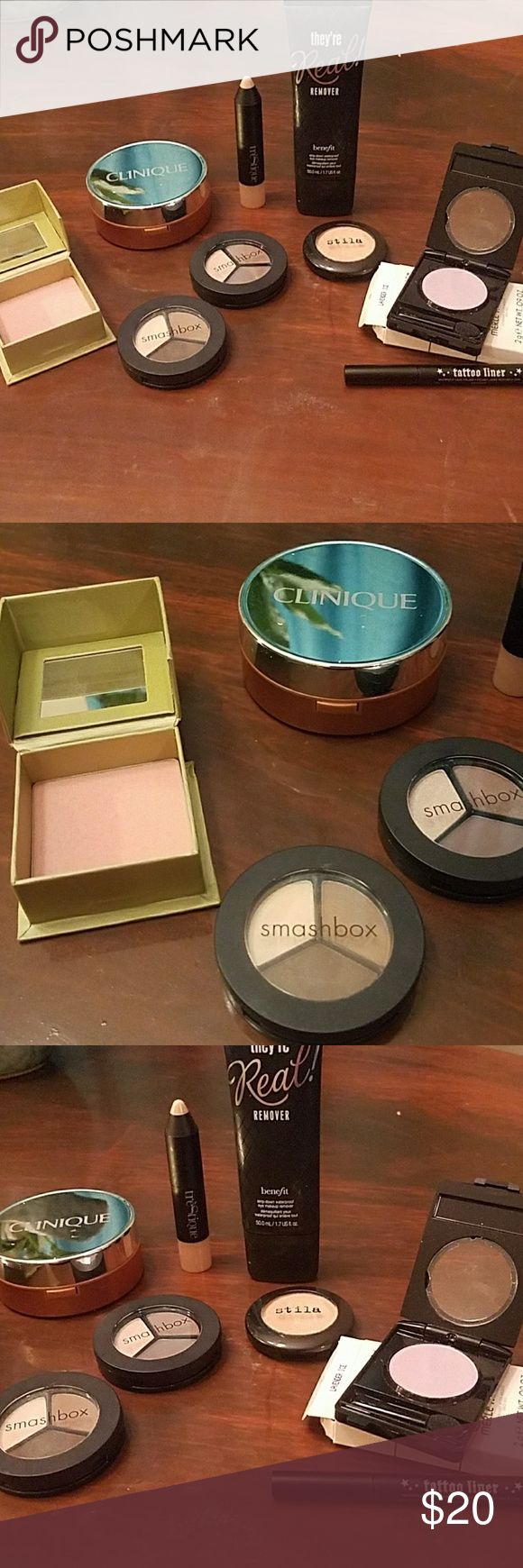 2 Brandnew 7 gently used high end make up lot 1 brand new Merle NORMAN eyeshadow in lavender ice 1 brand new Kat von d Tattoo liner sample size   1 used benefit dandelion blush  1 used clinique loose powder bronzer  2 used smash box trios in cover shoot and filter  1 used trestique highlighting stick  1 used stila eye shadow in oasis  1 used benefit they're real waterproof make up remover Sephora Makeup
