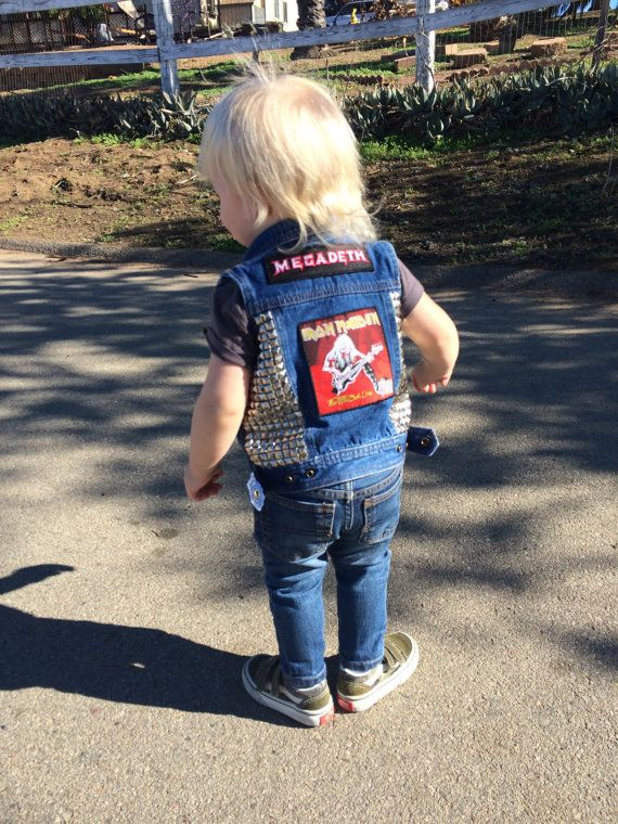 Repurposed denim Osh Kosh vest, now a Heavy Metal vest displaying Megadeath, Motorhead and Iron Maiden patches. Pyramid studs (re-purposed