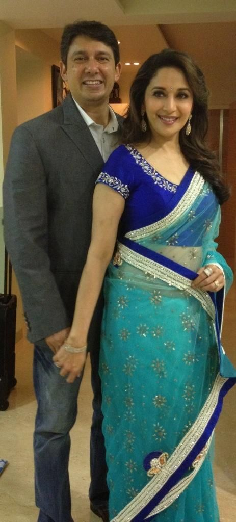 Madhuri Dixit in Blue Saree with her husband during Asha Parekh's 70th Birthday. I tagged this for the love between these. Not for her sari.