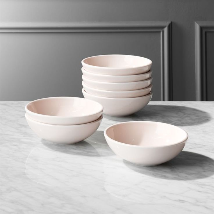 Shop Reveal Pink Soup Bowls Set of 8. Porcelain soup bowls with flat-edge rims serve in the loveliest light pink tone. Perfectly-weighted and ultra-durable. Pairs sweet with soft pink dinner and salad plates. CB2 exclusive.