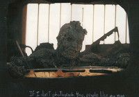 This photo at first was regarded by many editors as too disturbing to print, but later became one of the most famous images of the first Gulf War. The death of an incinerated Iraqi soldier on the Highway of Death, 1991. The Highway of Death refers to a six-lane highway between Kuwait and Iraq.