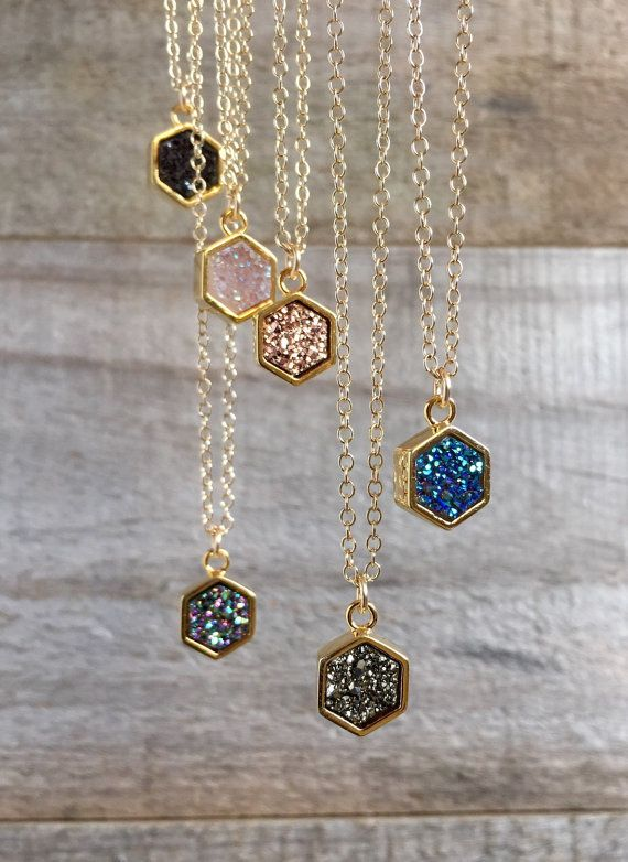 Super sparkly druzy quartz gemstone glides freely on a delicate cable chain. Natural, geometric shaped druzy stone is vapor coated with titanium to bring out a brilliant, consistent color. It is housed in a bright bezel setting, creating a beautiful contrast of tones and textures. Stone measures approximately 8mm; pendant measures approximately 9mm. Available in either silver or gold bezel setting.