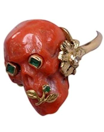 Whoa, I'm guessing this is carved carnelian or coral, it's pretty gnarly.