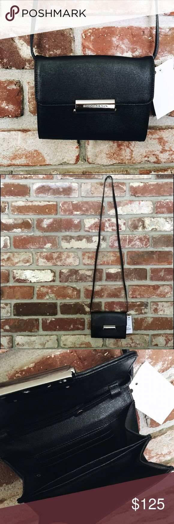 Black Mandarina Duck Cross Body Bag Gorgeous black with dark black silver enclosure. Keeps your items safe with a latch than can only open by pressing the side button. 3 compartments inside with card holders. Brand new with tag, purchased in London, UK! Mandarina Duck Bags Crossbody Bags