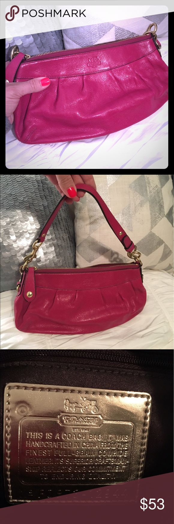 Authentic coach clutch / evening bag Authentic coach. Can be used as a clutch or with the strap as an evening bag. So pretty! Used maybe twice? Nice leather magenta color. Coach tags. Practically new. Coach Bags Clutches & Wristlets