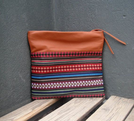 Check out this item in my Etsy shop https://www.etsy.com/listing/236612764/boho-clutch-impregnated-colorful-fabric