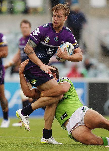 Cameron Munster (Melbourne Storm) is tackled