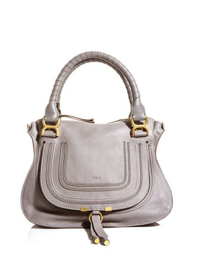 Chloé grey double-handle tote. Always a chic choice whatever the season, this roomy carryall references a Parisian elegance that will never go out of vogue.     $1,571