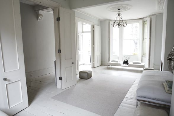 Victorian terrace house, white wooden floors, grey accessories.