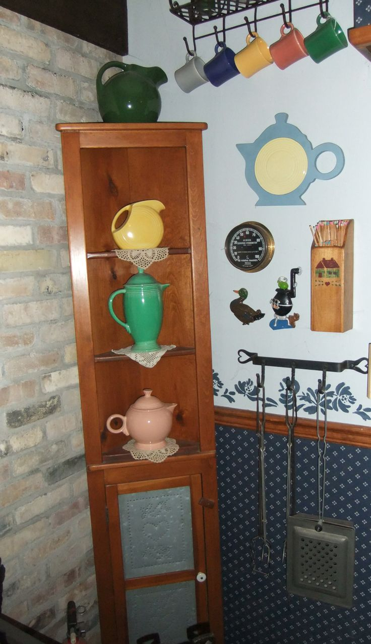 Vintage fiesta with the contemporary apricot teapot and contemporary trivet.