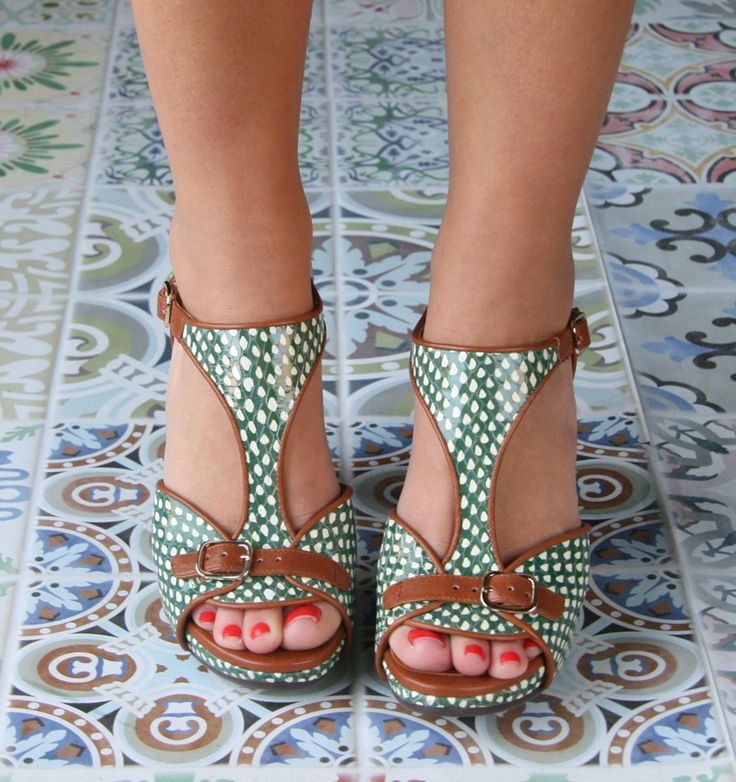 Green and white sandals with tan buckles by Chie Mihara