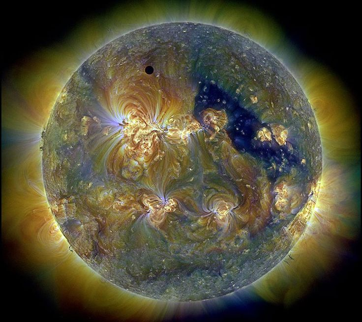 THE ECLIPSE OF VENUS  Pictured above during the occultation, the Sun was imaged in three colors of ultraviolet light by the Earth-orbiting Solar Dynamics Observatory, with the dark region toward the right corresponding to a coronal hole.  The next Venusian solar eclipse will occur in 2117. Image NASA, Peter L Dove