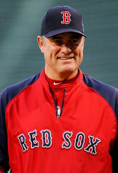 Manager John Farrell #53 of the Boston Red Sox watches batting practice before Game Two of the ALCS.