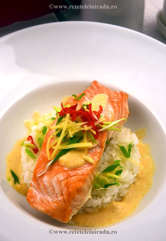 Salmon with ginger, thai red curry paste and coconut milk sauce, served with Jasmine rice