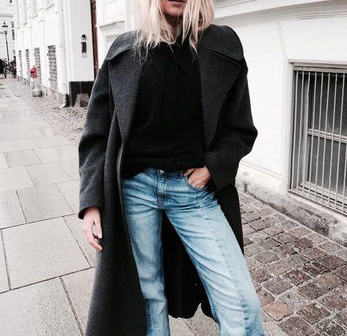 grey duster coat + black mockneck + light denim jeans
