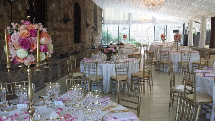 golden candebra and pink roses centerpiece