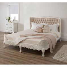 Bedroom. pearl white carved wooden bed frame with tufted button headboard and pastel brown sheet on brown floor. Wooden Queen Bed Frame With Storage Interior Ideas