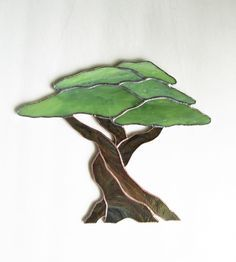But I am like an olive tree flourishing in the house of God; I trust in God's unfailing love for ever and ever. Psalm 52:8 This Olive tree was the first stained glass piece that someone commisioned from me. The order was from a man that had traveled to Israel and was so enamored