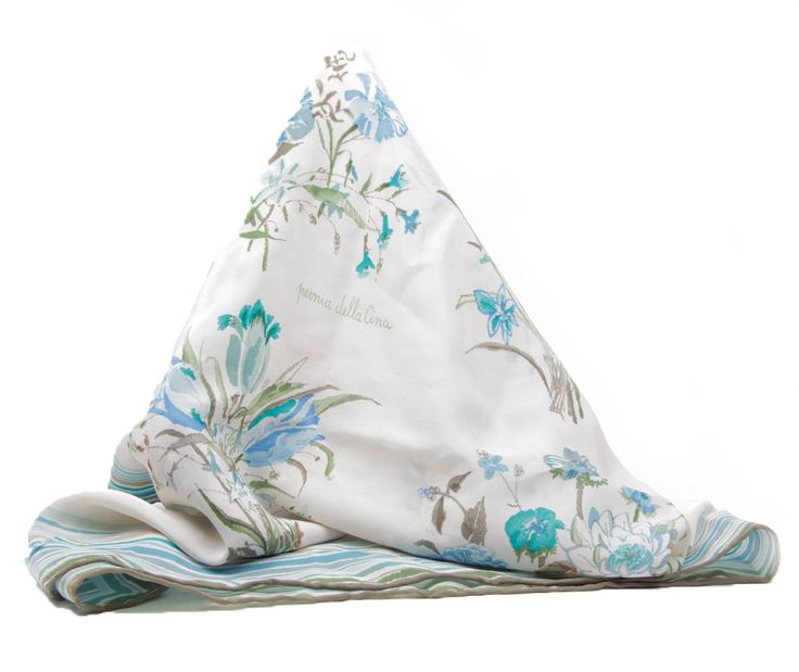 Own a piece of history with this beautiful vintage Gucci Scarf with a botanical theme. Both plant designs and names can be found throughout the pattern of the scarf, including an iris, giglio tigrato, agrifoglio, peonia della cina, ninfea, tulipano, giglio, and papavero. $375.00